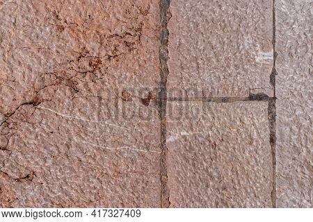 Old Brown Stone Wall With Cracks