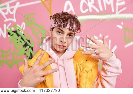 Self Confident Hooligan Youngster Makes Yo Gesture Feels Cool Wears Stylish Sweatshirt And Vest Head