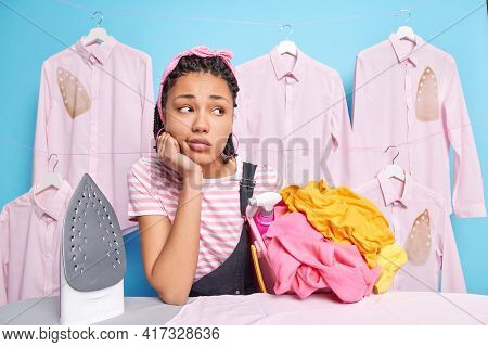 Pensive Sad Woman Leans On Ironing Board Takes Break Has Hard Working Busy Day Concentrated Away Tho
