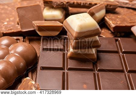 Stacked Chocolate Bars. Dark And Milk Chocolates With Nuts, Assorted Sweet Bar. Composition Of Bars