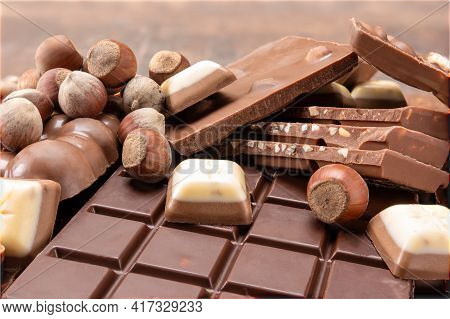Chocolate Bars With Nuts. Top View Of Chocolate Bar With Hazelnuts. Chocolate Background. Bars And S