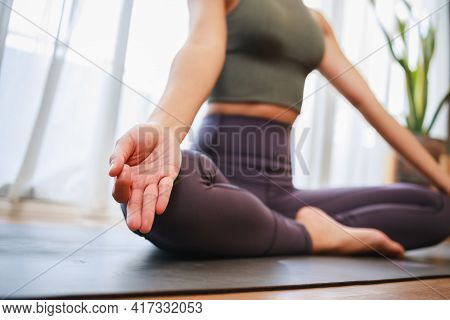 Yoga, Lotus Pose Close Up Of Hand Woman While Sitting On The Yoga Mat In The Living Room At Home