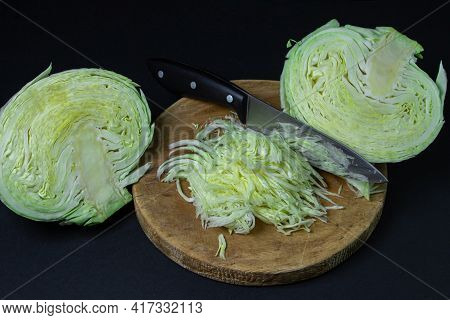 Cabbage On A Dark Background. Shredded Cabbage On A Black Background. Young Fresh Cabbage. Healthy D