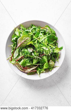 Organic Green Salad, Fresh Leaves Mix Salad With Arugula, Swiss Chard And Lettuce On White Backgroun