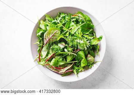 Healthy Green Salad, Fresh Organic Leaves Mix Salad With Arugula, Swiss Chard And Lettuce On White B