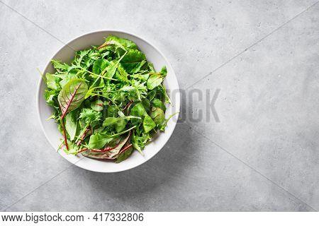 Healthy Green Salad, Fresh Organic Leaves Mix Salad With Arugula, Swiss Chard And Lettuce, Light Gra
