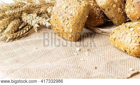 Delicious Bread. Fresh Loaf Of Rustic Traditional Bread With Wheat Grain Ear Or Spike Plant On Linen