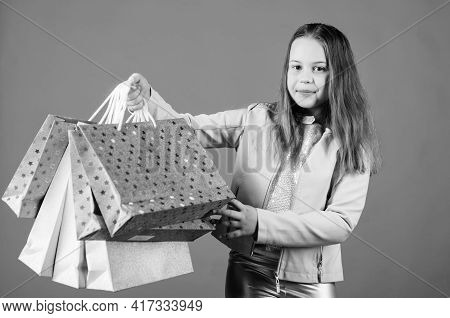 Happy Child. Little Girl With Gifts. Holiday Purchase Saving. Kid Fashion. Shop Assistant With Packa