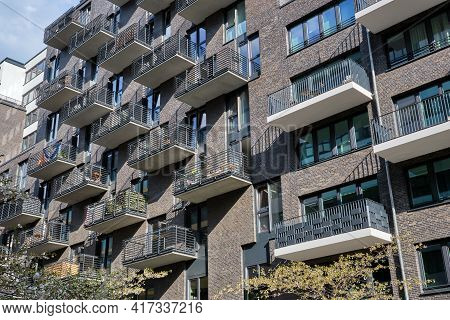 Modern Gray Apartment Building With Many Balconies Seen In Berlin, Germany