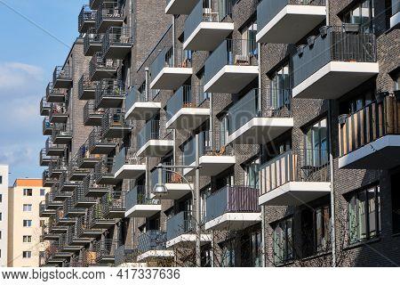 Modern Gray Apartment Building Made Of Bricks Seen In Berlin, Germany