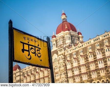 Mumbai Signboard In Marathi Language With Heritage Grand Class Five-star Hotel Taj, Next To The Gate