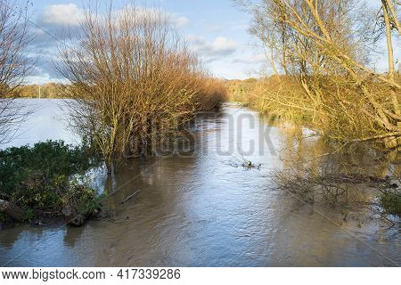 Overflowing, Swollen River With Flooding In Adjacent Fields. Buckinghamshire, Uk