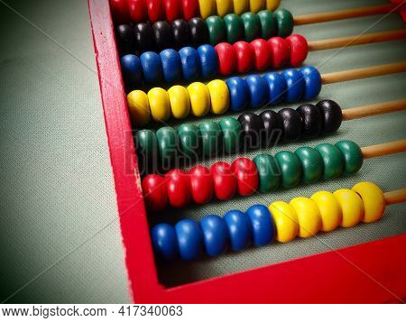 Education Concept - Abacus With Many Colorful Beads. Red, Blue, Green, Black, Yellow Details On The