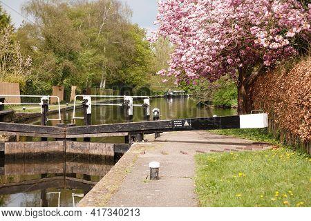 Grand Union Canal. Canal Lock With Narrow Boat In London Green Belt Landscape. Uxbridge, London, Uk