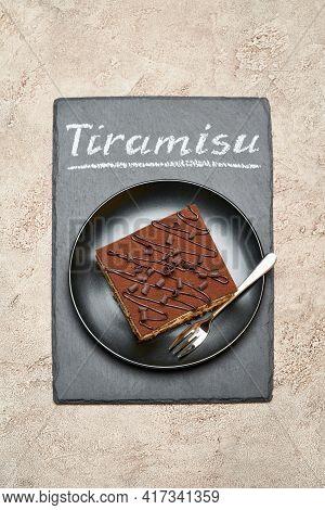 Portion Of Traditional Italian Tiramisu Dessert On Stone Serving Board With Chalk Handwritten Text S