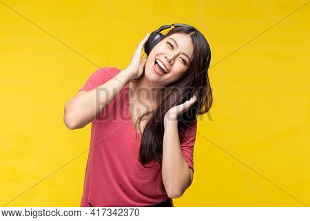 Asian Girl Dance Listening Music From Headphone. Young Happy Woman Using Cellphone Listen Music Via
