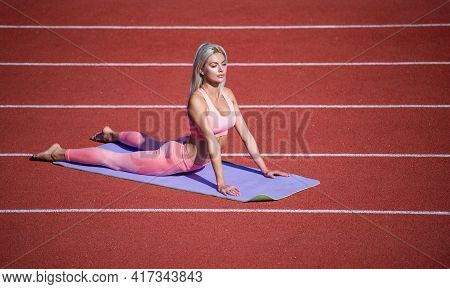 Woman With Sexy Fitness Body In Sportswear Training On Yoga Mat On Stadium, Pilates