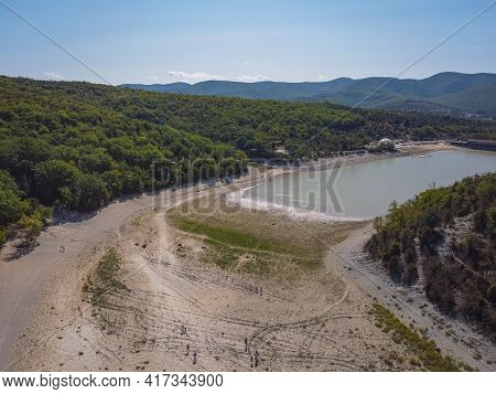 Aerial View Of Mountain Lake Surrounded By Fir Trees, Top View Of Lakes In Wooded Mountains
