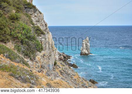 A Piece Of Rock Near The Sea Near The Coast, A View Of The Coastal Rocks Near The Castle Swallow's N