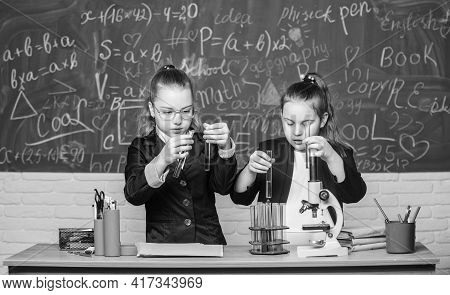 Doing Research. Biology Science. Happy Little Girls. Little Girls Scientist Work With Microscope. Ch