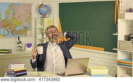 Its Coffee Break. Senior Teacher Drink Coffee In Restroom. Enjoying Rest During School Break. Break
