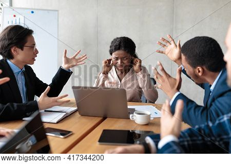 Angry Colleagues Shouting At Female Manager During Meeting In Office