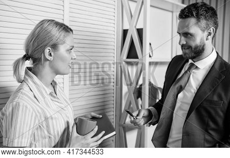 Love Affair At Work. Business Couple. Handsome Man Speak To Cute Woman In Office. Office Life. Boss