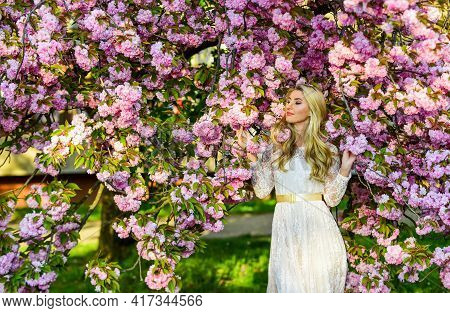 Aroma Concept. Seasonal Allergy. Lost In Flowers. Girl Cherry Flower Blossom. Spring Fashion. Woman
