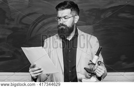 Teacher Bearded Man Hold Documents And Microscope Chalkboard Background. Explaining Theory. College