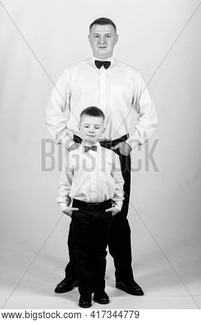 Gentleman In Tuxedo Style. Father And Son In Formal Suit. Happy Child With Father. Business Meeting