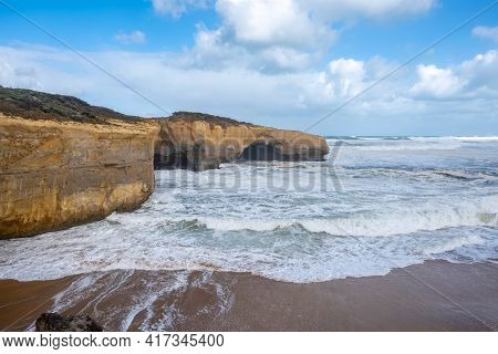 Strong Ocean Waves And London Bridge Rock Formation On The Famous Great Ocean Road In Victoria, Aust