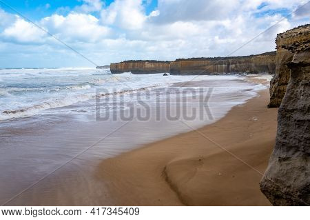 Scenic Beach With Rugged Limestone Cliffs On The Famous Great Ocean Road In Victoria, Australia