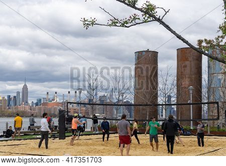 Brooklyn, Ny - Usa - April 17, 2021: A View Of People Enjoying  A Game Of Volley Ball At Domino Park