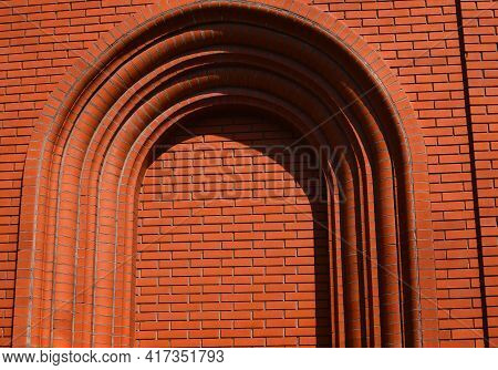 Arch Red Brick Wall. Arch Texture Background