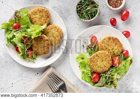 Vegan Burgers With Quinoa In Plates With Salad
