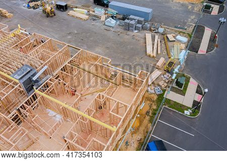 Stacked Wooden Building Materials Stack A New Development Framing Of New House Under Construction Re