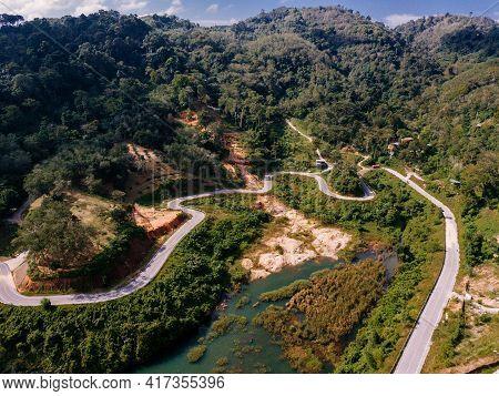 Serpentine Highway Among The Green Rich Tropic Rainforest. Birds Eye View