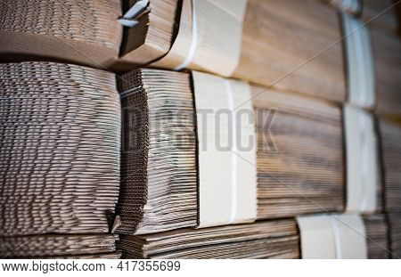 Close-up Large Cardboard Piles Lie On Top Of Each Other In A Warehouse. Concept Of Storage Of Things