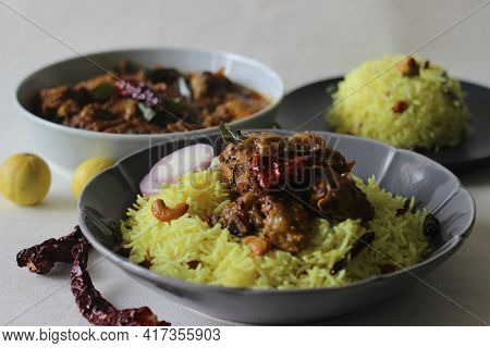 Homemade Lemon Rice Served With Kerala Style Chicken Curry