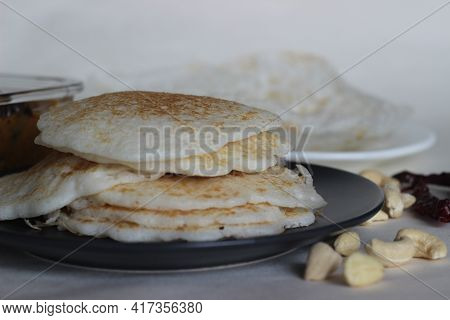Rice Pancakes And Hoppers. Two Types Of Red Rice Breakfast Dishes Along With Chicken Curry Made With