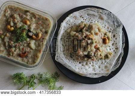 Fermented Rice Pancakes Made With Fermented Rice Batter And Coconut Milk Served Along With Mixed Veg