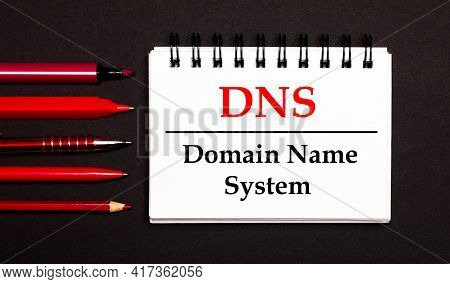 A White Notepad With The Text Dns Domain Name System, Written On A White Notepad Next To Red Pens, P