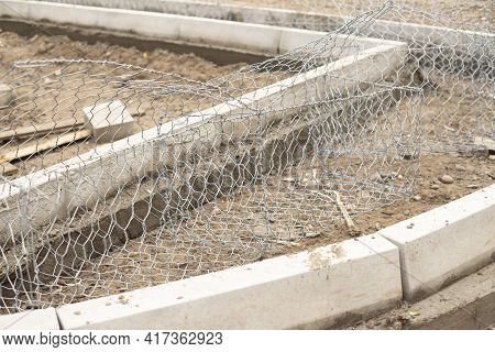 Concrete Curbs And Wire Mesh On The Site.