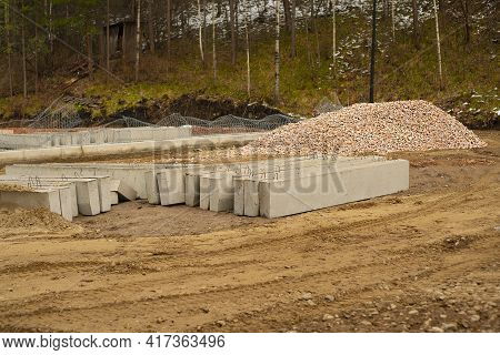 Concrete Curbs And Red Gravel On The Site.