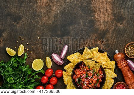 Traditional Mexican Tomato Sauce Salsa With Nachos And Ingredients Tomatoes, Chile, Garlic, Onion On