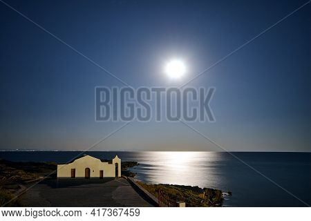 The Facade Of The Orthodox Chapel Illuminated By Moonlight On The Coast Of The Island Of Zakynthos I