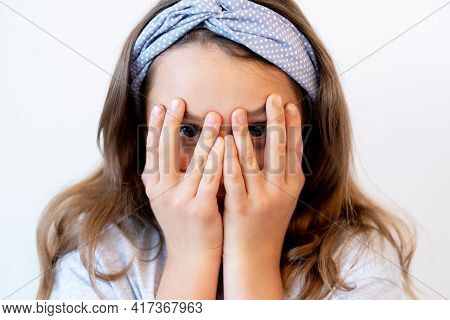 Scared Child. Hide And Seek Game. Curiosity Discovery. Frightened Shy Afraid Cute Little Girl Playin