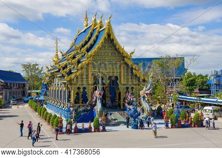 Chiang Rai, Thailand - December 17, 2018: View Of Ubosot Of The Buddhist Temple Wat Rong Sear Tean (
