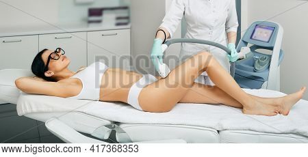 Legs Laser Hair Removal. Beautician Removes Hair On Beautiful Female Legs Using A Medical Laser. Las