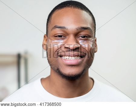 Man Skincare. Facial Treatment. Anti-aging Procedure. Happy Satisfied African Guy In White T-shirt W